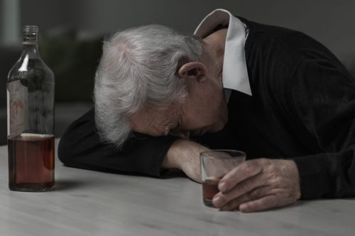 man drinking whiskey - AUD in Elders Concept