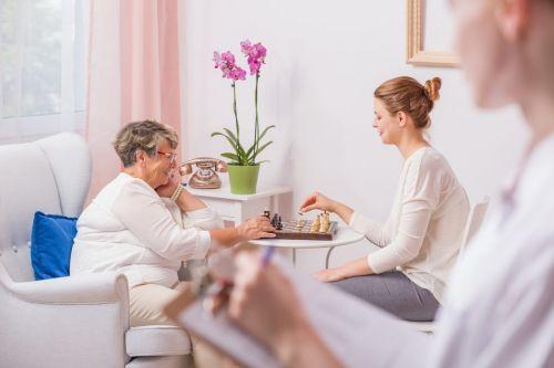 Women playing chess - nursing home concept