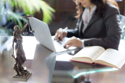 woman working at a desk - probate attorney concept