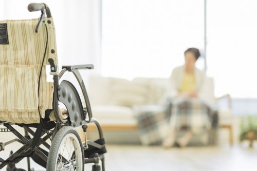Senior lady and a wheelchair - Elder Care Concept
